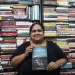 Fiza Pathan posing with the book The Novelist by Angela Hunt